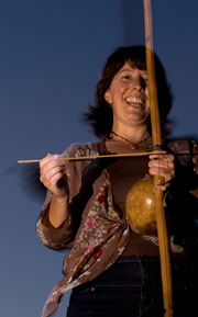 Christina plays the berimbau